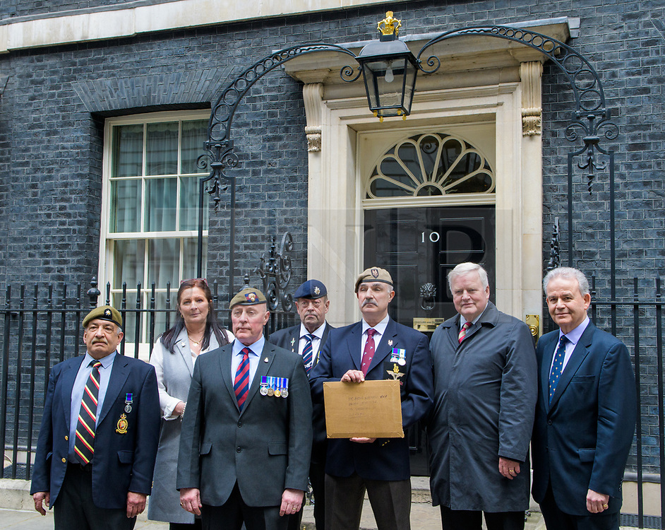 © Licensed to London News Pictures. <br /> 14/4/2017. London, Great Britain. <br /> Pete Payner, 1 Angalians, Maggie Harkins, 5 UDR, Laurence Elliott, 2 Grenadier Guards, Geoff Edwards, RCT, Robin Horsfall former 22 SAS, Col Bob Stewart, Cheshire, Dr. Julian Lewis MP, fromer RNR hand in a letter to the Prime Minister during the Justice for Northern Ireland Veterans March in central London.<br /> They are protesting the prosecution of former Service men and women who served in Northern Ireland during the Troubles.<br /> Photo credit: Anthony Upton/LNP