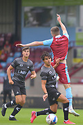 Reece James of Doncaster Rovers u23 battles for possession with Bournemouth loanee Frank Vincent (23) of Scunthorpe United during the Pre-Season Friendly match between Scunthorpe United and Doncaster Rovers at Glanford Park, Scunthorpe, England on 15 August 2020.