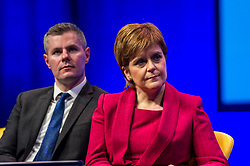 Pictured: Derek Mackie, MSP , Cabinet Secretary for Finance and the Constitution and Nicola Sturgeon, First Minister;<br /> The members of the SNP gathered in the Scottish Events Centre in Glasgow for their annual conference.<br /> <br /> Ger Harley | EEm 8 October 2017