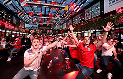 Fans watch the UEFA Euro 2020 Group D match between Czech Republic and England at BOXPARK in Croydon. Picture date: Tuesday June 22, 2021.
