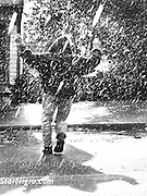 Dancing in the rain on the streets of Woodstock,NY. A portrait of the one & only Jogger John. photo by Star Nigro<br /> <br /> <br /> © 2021  All artwork is the property of STAR NIGRO.  Reproduction is strictly prohibited.