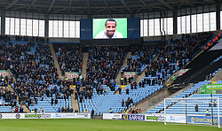 Coventry City's fans observe the minutes applause in memory of the late Cyrille Regis