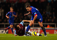 Photo: Daniel Hambury.<br />West Ham United v Manchester United. The Barclays Premiership. 27/11/2005.<br />West Ham's Yossi Banayoun and Manchester's Alan Smith battle for the ball.