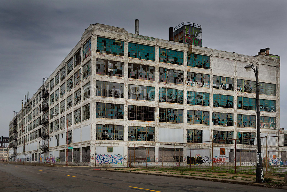 """Abandoned factory near the city centre, Detroit. Known as the world's traditional automotive center, """"Detroit"""" is a metonym for the American automobile industry and an important source of popular music legacies celebrated by the city's two familiar nicknames, the Motor City and Motown. Many neighborhoods remain distressed since the collapse of the motor industry. The state governor declared a financial emergency in March 2013, appointing an emergency manager. On July 18, 2013, Detroit filed the largest municipal bankruptcy case in U.S. history."""