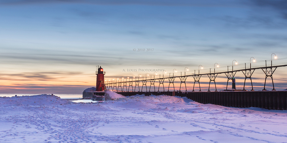 Twilight leaves a cool glow on the snow and ice on Lake Michigan