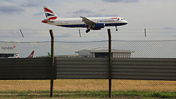 © Licensed to London News Pictures. 24/06/2015. Heathrow, UK Aircraft taking off and landing at Heathrow this week, Academic and business expert Sir Howard Davies is expected to report the findings of a commission within weeks. The commission was set up to decide which of Heathrow or Gatwick airports should be expanded.. Photo credit : Ian Wylie/LNP