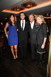 BEN CARING, his wife ELLE, RICHARD CARING and his wife JACKIE at 'Heavenly Ivy' a play to commemorate 20 years of The Ivy Restaurant, held at The Ivy, West Street, London on 8th November 2010.
