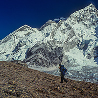 A trekker ascend a hill called Kala Patar for a view of Mounts Everest and Nuptse in the Khumbu region of Nepal's Himalaya.
