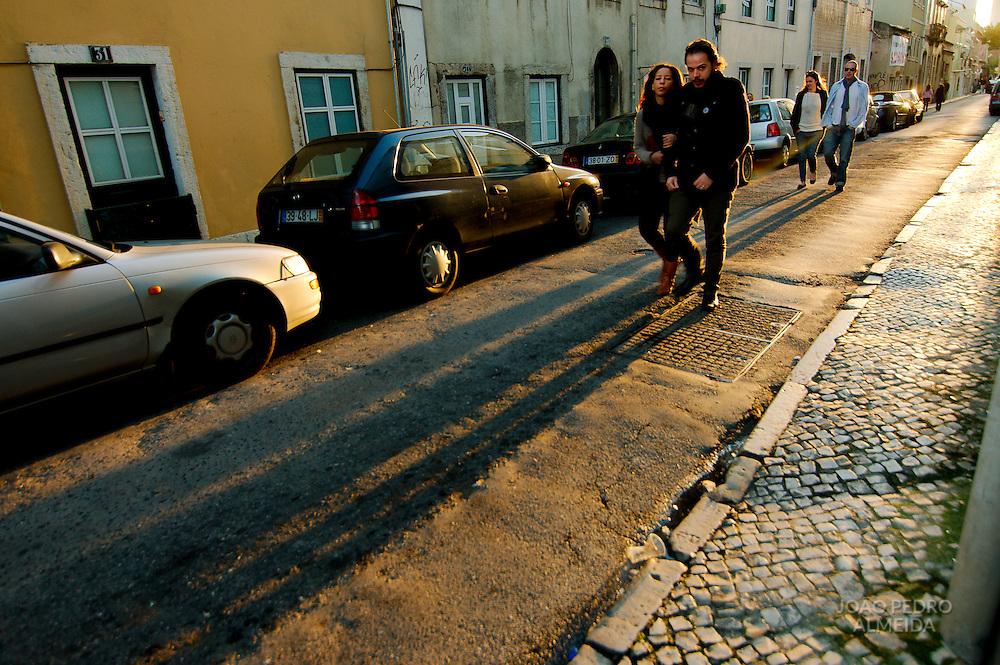 Couple walking a a Lisbon street on a sunny winter day
