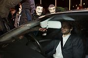 Protesters block a car. Bonfire night protest in central London by the activist group Anonymous, in a demonstration called the Million Mask March. Masked protesters created havoc as they marched on Parliament, and all over central London. The protest, which was organised in hundreds of cities, is said to be against austerity and infringement of human rights.