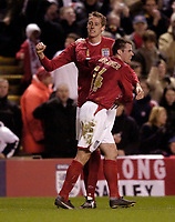 Photo: Jed Wee.<br /> England v Uruguay. International Friendly. 01/03/2006.<br /> <br /> England's Peter Crouch (L) celebrates with Liverpool team mate Jamie Carragher.