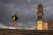 Gabriela Loyola runs in front of San Francisco Church in Puebla City, Mexico