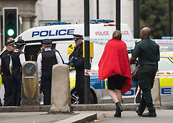 © Licensed to London News Pictures. 07/10/2017. London, UK.  An injured woman wrapped in a rad blanket at the scene of an incident outside the Natural History Museum. Early reports say a man has been arrested after pedestrians were injured in a collision with a car. Photo credit: Ben Cawthra/LNP