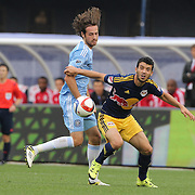 Felipe Martins, (right), New York Red Bulls, is challenged by Mix Diskerud, NYCFC, during the New York City FC Vs New York Red Bulls, MSL regular season football match at Yankee Stadium, The Bronx, New York,  USA. 28th June 2015. Photo Tim Clayton