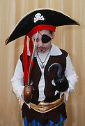 Young boy of 7 dressed up as a pirate for the Jewish celebration of Purim