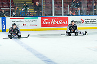 KELOWNA, BC - JANUARY 26: Brothers Cole Shepard #16 and Jackson Shepard #18 of the Vancouver Giants stretch on the ice during warm up against the Kelowna Rockets at Prospera Place on January 26, 2020 in Kelowna, Canada. (Photo by Marissa Baecker/Shoot the Breeze)