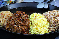 Bangkok Street Food Vendors, with a wok-full of Pad Thai - Pad thai sometimes spelled phad thai is a stir-fried noodle dish typically served as street food. It is normally made of rice noodles, prawns, a scrambled egg, peanuts with bean sprouts sprinkled on top.