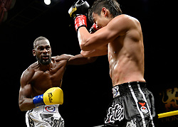 October 6, 2018 - Mashantucket, CT, U.S. - MASHANTUCKET, CT - OCTOBER 06: Julian Nguyen (red tape) takes on Micheal Lawrence (blue tape) in a Welterweight bout on October 06, 2018 at Lion Fight 47 at the Fox Theater of Foxwoods Casino in Mashantucket, Connecticut. Julian Nguyen defeats Micheal Lawrence via TKO of round 5. (Photo by Williams Paul/Icon Sportswire) (Credit Image: © Williams Paul/Icon SMI via ZUMA Press)