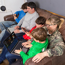 Eldest son Stevie, 15, Dad Chris, 44, , son Leo, 12, Mum Nancy, 43, and youngest son Indy, 7,  all manage to be online simultaneously as the connected family enjoys social media, gaming and work. Real-life case study campaign, showcasing BT's complete Wi-Fi offering. London, May 16 2019.
