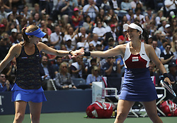 NEW YORK, Sept. 11, 2017  Yung-Jan Chan (R) of Chinese Taipei and Martina Hingis of Switzerland celebrate a point during the women's doubles final match against Lucie Hradecka and Katerina Siniakova of the Czech Republic at the 2017 US Open in New York, the United States, Sept. 10, 2017. Yung-Jan Chan and Martina Hingis won 2-0 to claim the title. (Credit Image: © Wang Ying/Xinhua via ZUMA Wire)