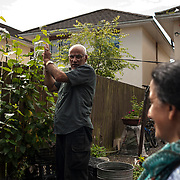 CARRICK-ON-SHANNON, IRELAND - AUGUST 17, 2017: Aziz Allakarami talks to his wife, Fawzieh Amiri as he works on his vegetable garden at his family home in Carrick-on-Shannon in Ireland. The Allakarami family were part of a group of more than one hundred Kurdish resettled from Iraq about 11 years ago in the small Irish town in the west of the country. Despite health issues preventing Mr. Allakarami to hold a full time job, he spends his days taking care of his vegetable garden and occasionally selling his products at the local farmers market. CREDIT: Paulo Nunes dos Santos for The New York Times