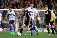 Chris McCann of Wigan Athletic gets in front of Tom Pope of Bury. Skybet football league one match , Bury v Wigan Athletic at the JD Stadium in Bury, Lancs on Saturday 10th October 2015.<br /> pic by Chris Stading, Andrew Orchard sports photography.