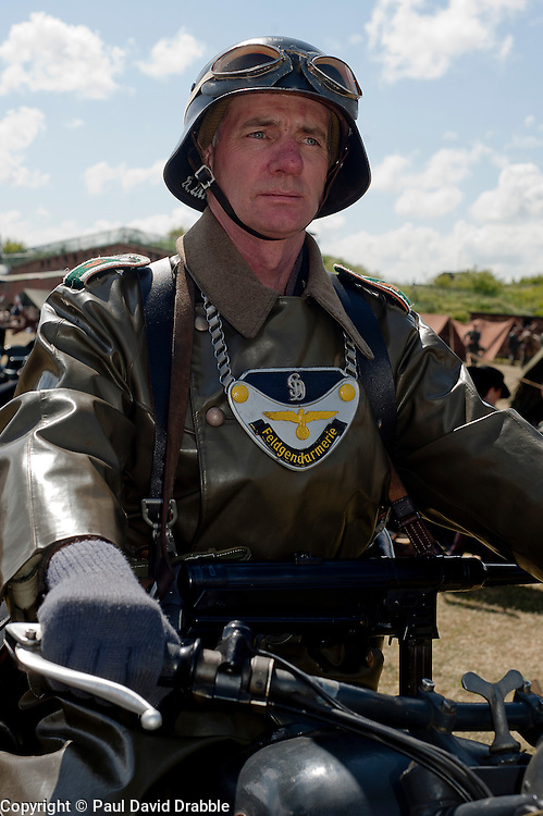 Known by German soldiers of the period as kettenhund or Chain Dogs a reenactor portrays a second world war Field Policeman at  Fort Paul<br /> 2 May 2011<br /> Image © Paul David Drabble