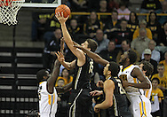 February 27 2013: Purdue Boilermakers forward Donnie Hale (15) puts up a shot between Iowa Hawkeyes guard Anthony Clemmons (5) and Iowa Hawkeyes center Gabriel Olaseni (0) during the first half of the NCAA basketball game between the Purdue Boilermakers and the Iowa Hawkeyes at Carver-Hawkeye Arena in Iowa City, Iowa on Wednesday, February 27 2013.