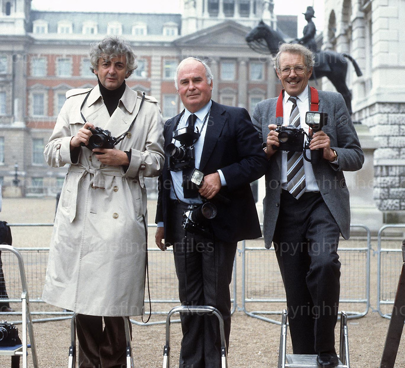 British photographers Ross Benson (left), Terry Fincher(centre) and Vic Blackman(right) on assignment in London in 1982.