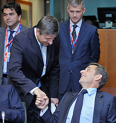 """Nicolas Sarkozy, France's president, right, speaks with Michael Spindelegger, Austria's foreign minister, during the European Union Summit at the EU headquarters in Brussels, Belgium, on Thursday, Oct. 29, 2009. European Union leaders are set for """"very difficult"""" talks to overcome the Czech Republic's resistance to a new governing treaty designed to strengthen the EU's influence in world affairs, Reinfeldt said. (Photo © Jock Fistick)"""