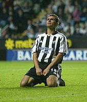 Photo. Andrew Unwin<br /> Newcastle v Partizan Belgrade, Champions League Third Qualifying Round, Second leg, St James' Park, Newcastle 27/08/2003.<br /> Newcastle's Aaron Hughes looks to the skies after missing his penalty.
