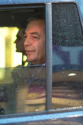 © Licensed to London News Pictures . 06/02/2017. Stoke-on-Trent, UK. NIGEL FARAGE seen in his car in Hanley this afternoon , 6th February 2017 . Former UKIP leader Nigel Farage will join current leader Paul Nuttall at a public meeting at Victoria Hall in Hanley , during Nuttall's campaign to win the seat of Stoke-on-Trent Central . Photo credit: Joel Goodman/LNP