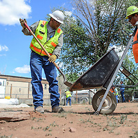 062714       Cayla Nimmo<br /> <br /> A crew from Environmental Restoration clears a home of uranium traces and brings in clean soil to replace Friday morning in Bluewater.