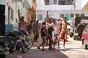 Boys enjoy the street celebrations during the festival of Holi, in Udaipur, Rajasthan, India