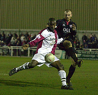 Picture: Raymond Field<br /><br /><br />Woking F.C v Kidderminster Harriers FA second round<br /><br />06/12/2003<br /><br /><br />Davis Haule trys to make