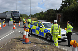© Licensed to London News Pictures. 28/07/2015<br /> Operation Stack chaos at Junction 8 of the M20 in Kent. Police in control of the M20.<br /> <br /> Operation stack is back on the M20 in Kent.<br /> Just days after Operation Stack was taken off the M20, it was brought back in the early hours of this morning.<br /> The authorities are blaming a heavy volume of traffic heading towards the Port of Dover and Eurotunnel and the continued disruption in Calais.<br /> The coast-bound carriageway between junctions 8 and 9 is closed to allow lorries to park, but the slip roads at junctions 9, 10 and 12 and 13 have also been shut. <br /> <br /> (Byline:Grant Falvey/LNP)