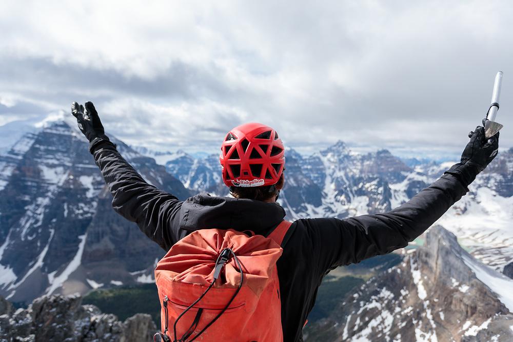 Pat Lindsay on the summit of Mt Aberdeen enjoying the views of Banff National Park, Ridgeline Guiding