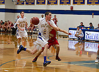 Gilford's Josh Joyce drives past Campbell's Justin DiBenedetto during NHIAA Division III quarterfinal matchup with Campbell on Saturday evening.   (Karen Bobotas/for the Laconia Daily Sun)