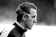 Harry Kane of Tottenham Hotspur wearing a clear protective face mask as he enters the pitch before k/o. note : image has been converted to black & white. Barclays Premier league match, Tottenham Hotspur v Swansea city at White Hart Lane in London on Sunday 28th February 2016.<br /> pic by John Patrick Fletcher, Andrew Orchard sports photography.