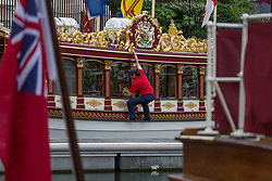 © Licensed to London News Pictures.  03/09/2021. London, UK. A man cleans windows at St Katharine Docks Marina on the River Thames ahead of the Classic Boat Festival this weekend. With 40 vintage sail and motor yachts, the Classic Boat Festival is part of Totally Thames' 25th festival. Photo credit: Marcin Nowak/LNP