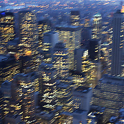 A blurred view of the city lights of Manhattan, New York, at dusk from the Top of the Rock, the observatory deck at Rockefeller Center showing the Empire State Building, Manhattan, New York, USA.  Photo Tim Clayton