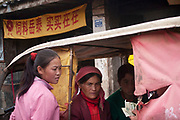 A deal being done in the back of a vehicle near Lugu Lake, Yunnan, China.