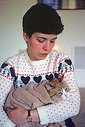 Joni Praded Holding Cat With Towel