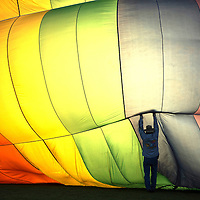 Cliff Skocgopole adjusts the balloon Sir Flies A Lot during inflation Sunday morning to take part in the Farewell Ascension of the Albuquerque International Balloon Fiesta.