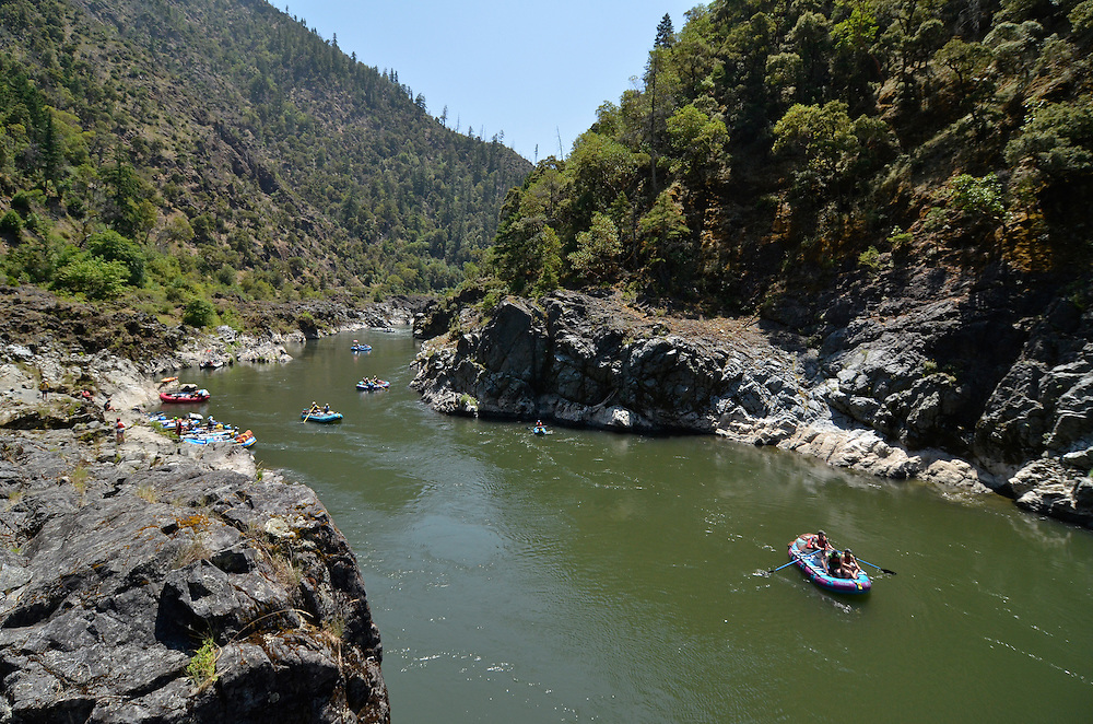 Rafts on a calm section of Oregon's Rogue River.