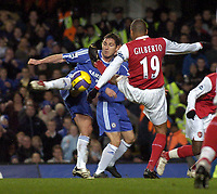 Photo: Olly Greenwood.<br />Chelsea v Arsenal. The Barclays Premiership. 10/12/2006. Chelsea's Frank Lampard shoots at goal past Arsenal's Gilberto