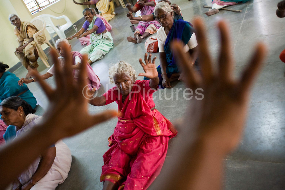 A daily exercise class for residents at the Tamaraikulum Elders's Village, Cuddalore, Tamil Nadu, India