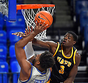 Arkansas-Pine Bluff Golden Lions forward Markedric Bell (3, right) tries to block the shot of St Louis Billikens forward Hasahn French (11). St. Louis University hosted the University of Arkansas - Pine Bluff in a mens basketball game on December 5, 2020 at Chaifetz Arena on the SLU campus in St. Louis, MO.<br />Photo by Tim Vizer
