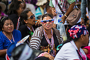 16 MAY 2014 - BANGKOK, THAILAND: A PDRC protestor with sunglasses in the Thai national colors sits in the street in front of the Thai parliament building in Bangkok. Thousands of protestors from the People's Democratic Reform Committee (PDRC) surrounded the Thai Parliament complex Saturday to pressure the Thai Senate to select an interim Prime Minister to replace ousted former PM Yingluck Shinawatra. The Senate decided not to appoint an interim PM of their own and announced a meeting with the current interim Prime Minister. The protestors left the parliament complex and threatened to return in larger numbers if the Senate doesn't act. The Senate appointment of an acting PM could plunge Thailand into chaos since there is already an interim Prime Minister from the ruling Pheu Thai party.     PHOTO BY JACK KURTZ