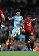Leroy Sane of Manchester City and Anthony Martial of Manchester United during the English Premier League match at The Etihad Stadium, Manchester. Picture date: April 27th, 2016. Photo credit should read: Lynne Cameron/Sportimage